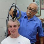 a summer camper gets a new hair cut.
