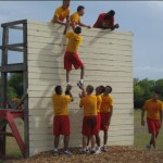 Negotiate a wall obstacle at MMA Summer Camp