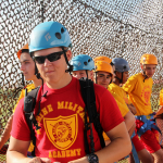 A summer camp instructor on the rappel tower